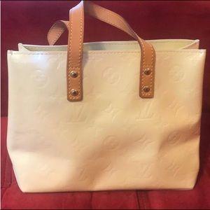 Louis Vuitton Vernis leather Reade Pm Handbag.